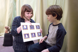 Megan Sauter shows seven-year-old Damian Franchere a map