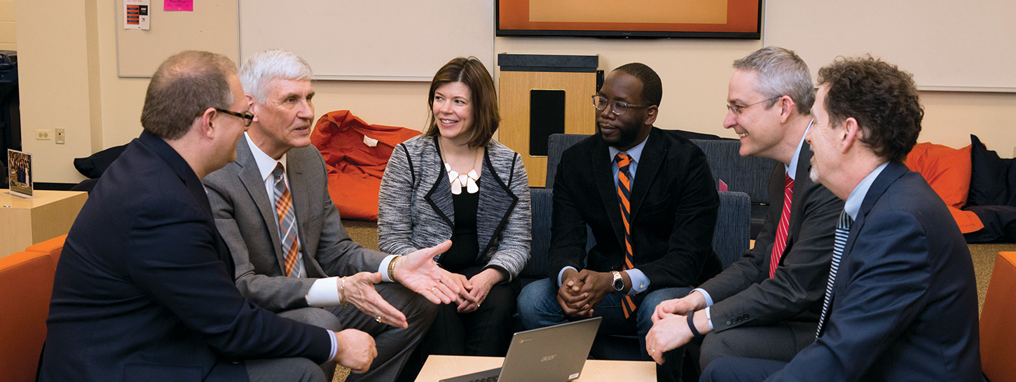 SESP Dean David Figlio, ETHS Superintendent Eric Witherspoon, IPR director Diane Whitmore Shanzenbach, ETHS Principal and Assistant Superintendent Marcus Campbell, ETHS Assistant Superintendent Pete Bavis, and District 65 Superintendent Paul Goren review ongoing research at the high school.